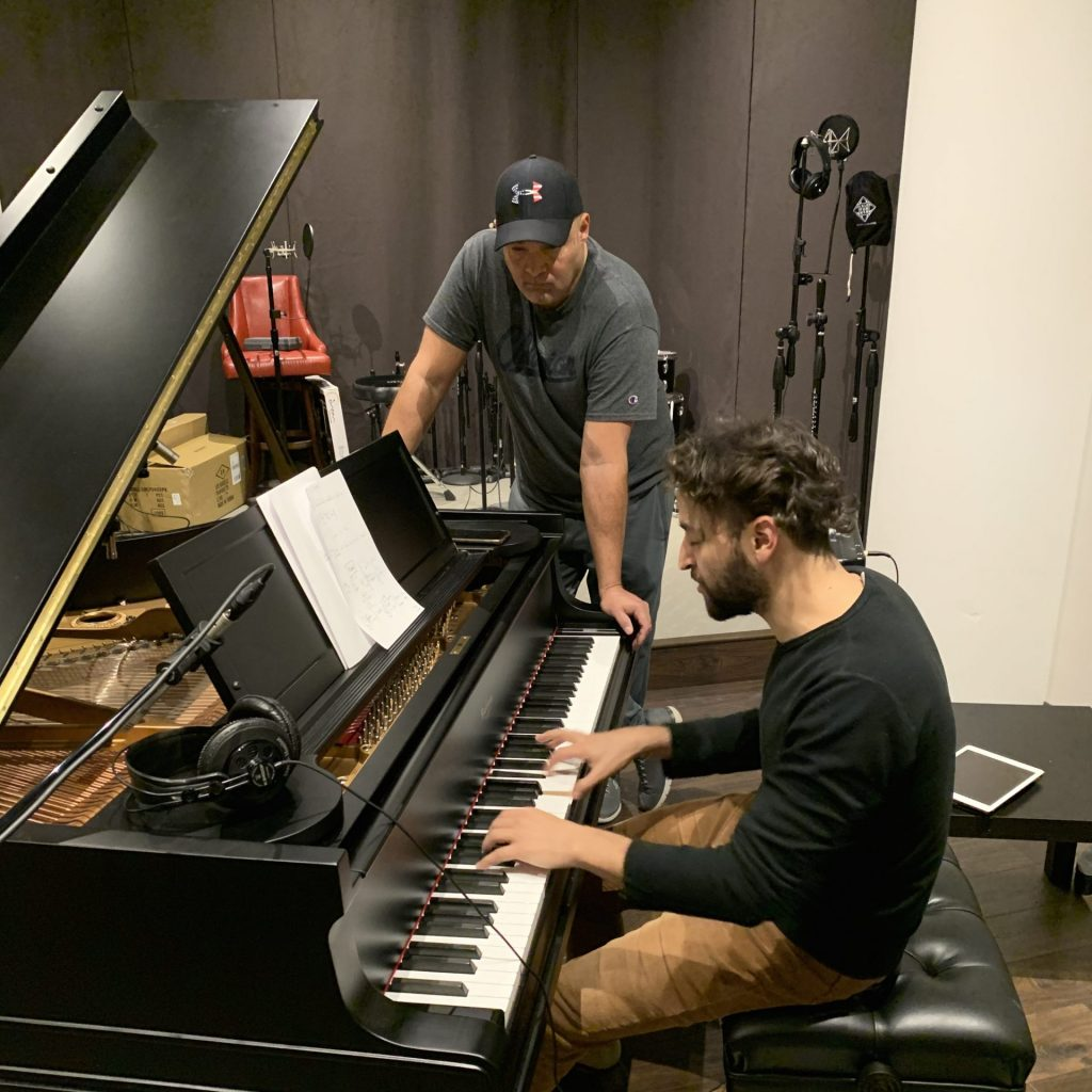 Sebastian playing Baldwin grand piano